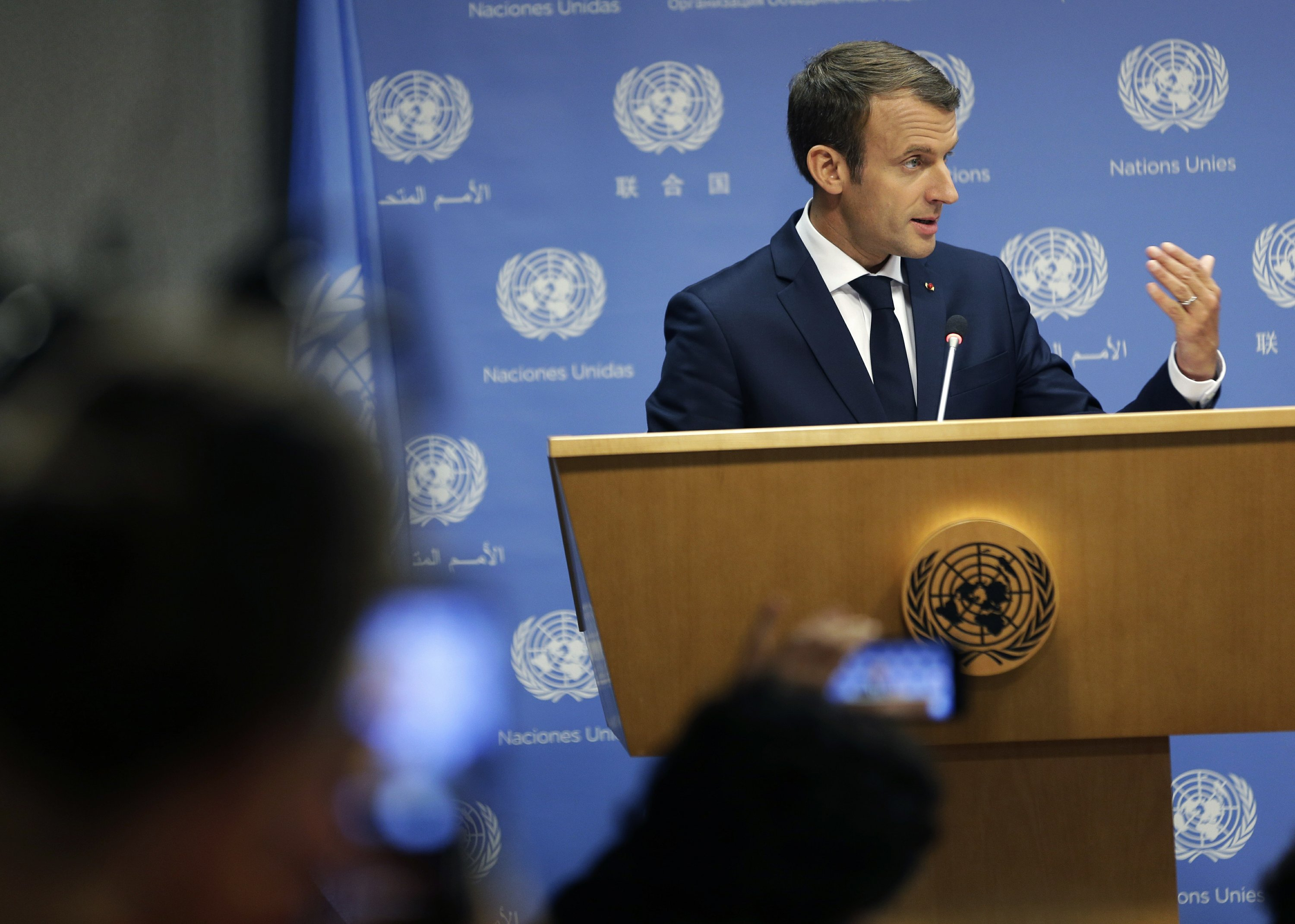 The Latest: French president calls US climate move a mistake