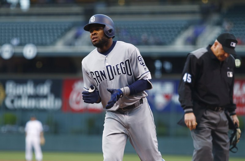 San Diego Padres' Manuel Margot applauds after crossing home plate on his home run off Colorado Rockies starting pitcher Antonio Senzatela during the first inning of a baseball game Tuesday, April 11, 2017, in Denver. (AP Photo/David Zalubowski)