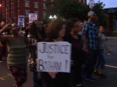 Protesters denounce Dallas police shooting
