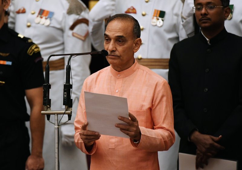 Former Mumbai police chief Satyapal Singh, takes the oath during the swearing-in ceremony of new ministers at the Presidential Palace in New Delhi, India, Sunday, Sept.3, 2017. India Prime Minister Narendra Modi, on Sunday reshuffled some of his key minister's portfolios to refurbish his government's image, which has been dented by falling economic indicators.