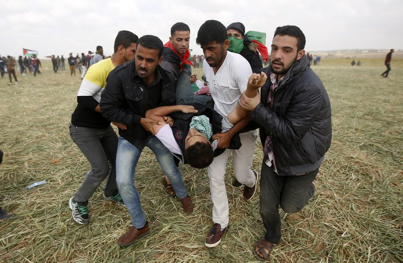 Israel says will expand response if clashes go on