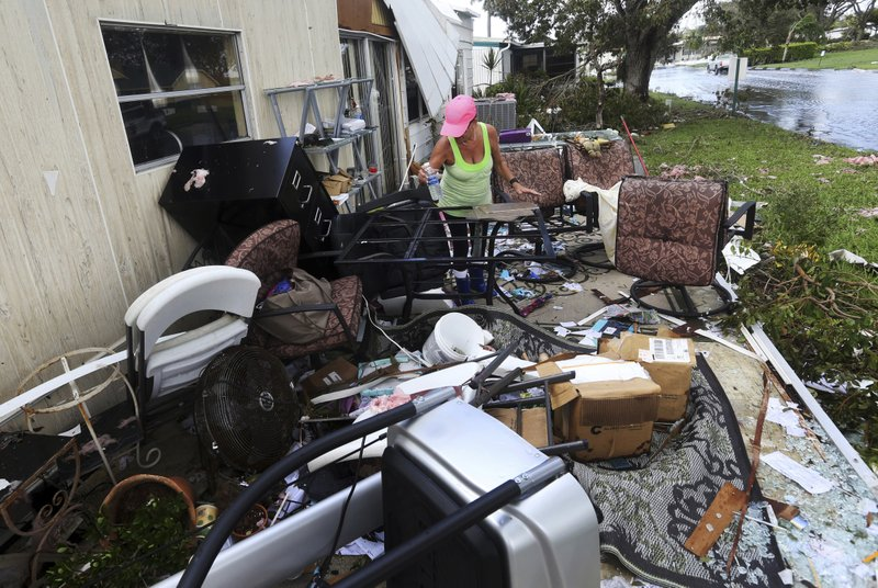 Olga Teakell Cleans Debris From Olgas Destroyed Home In The Naples Estates Mobile Park Aftermath Of Hurricane Irma Fla Monday