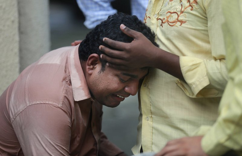 An Indian man mourns outside a morgue for a relative killed in a pedestrian bridge stampede, in Mumbai, India, Friday, Sept. 29, 2017. The stampede broke out on a crowded pedestrian bridge connecting two railway stations in Mumbai during the Friday morning rush, killing a number of people police said.