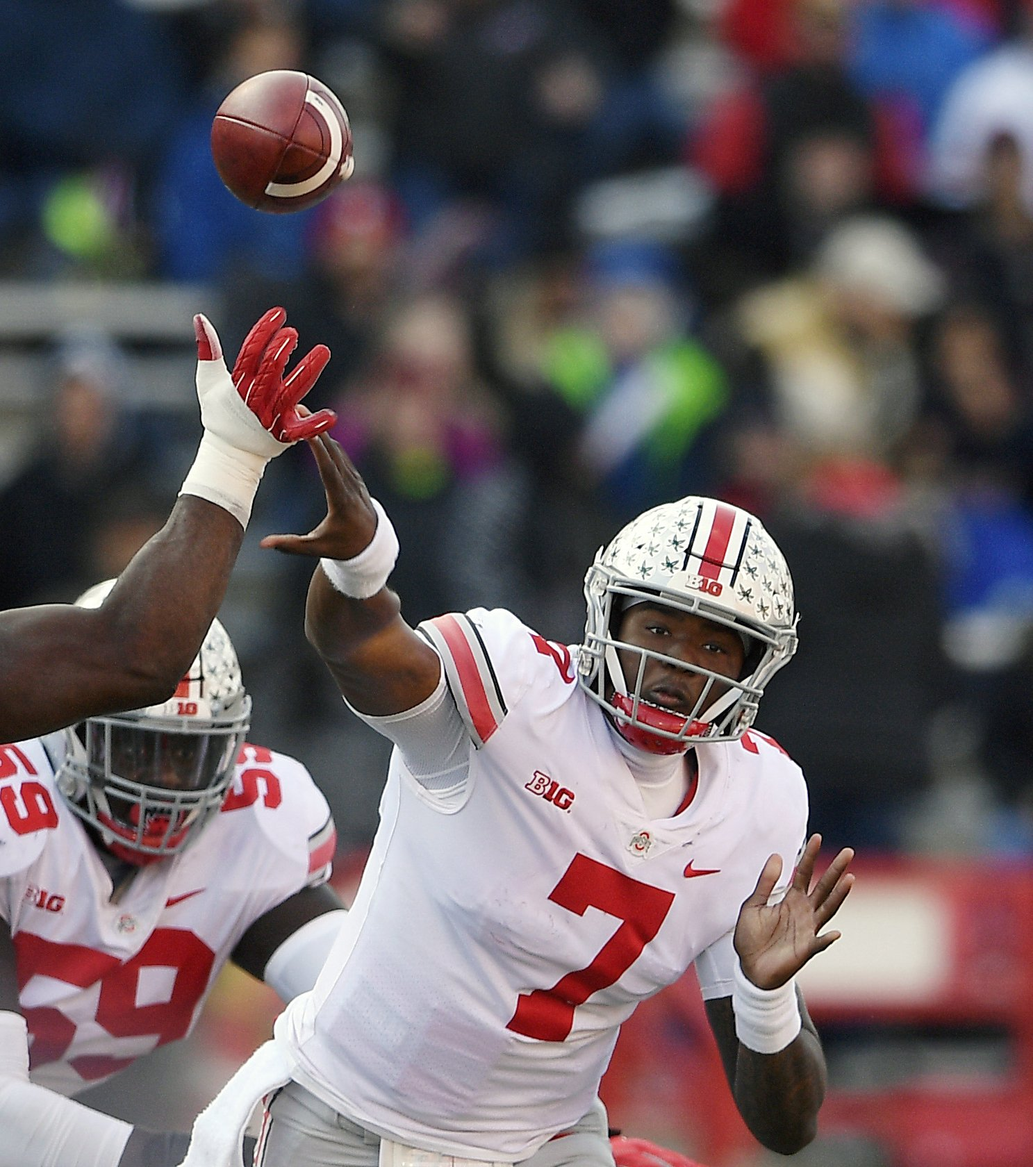 Haskins, Bush receive the highest awards from the AP All-Big Ten Team - Associated Press