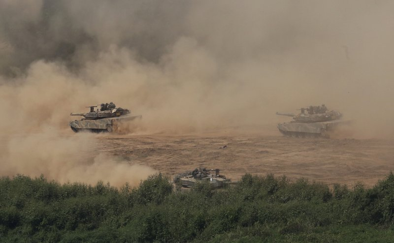 "In this Monday, Sept. 4, 2017, file photo, South Korean army's K-1 tanks move during a military exercise in Paju, South Korea, near the border with North Korea. Following U.S. warnings to North Korea of a ""massive military response,"" South Korea's military on Monday fired missiles into the sea to simulate an attack on the North's main nuclear test site a day after Pyongyang detonated its largest ever nuclear test explosion."