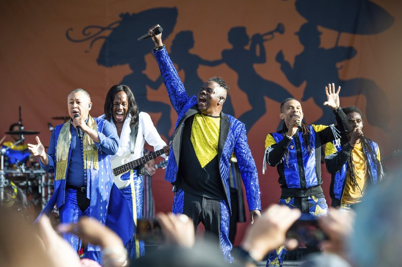 The Latest: Two-stepping in the mud at Jazz Fest, Day 2