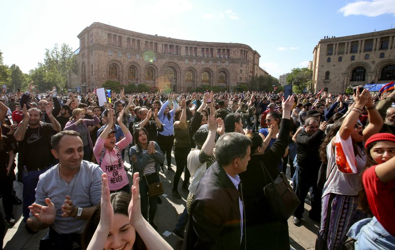 People celebrate Armenian Prime Minister's Serzh Sargsyan's resignation in Republic Square in Yerevan, Armenia, Monday, April 23, 2018.
