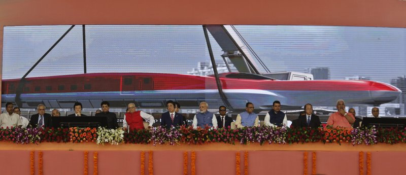 Japanese Prime Minister Shinzo Abe, front row, sixth left and Indian Prime Minister Narendra Modi, front row seventh left, attend the ground breaking ceremony for high speed rail project in Ahmadabad, India, Thursday, Sept. 14, 2017.