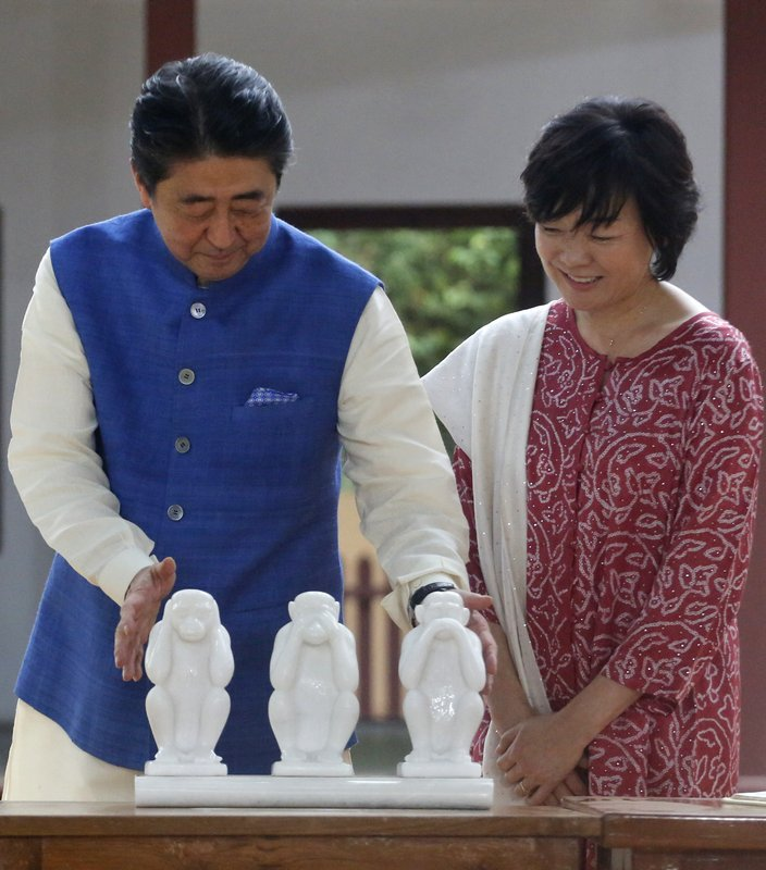 Japanese Prime Minister Shinzo Abe and his wife Akie Abe look at sculptures of three proverbial monkeys at Sabarmati Ashram, or Gandhi Ashram, in Ahmadabad, India, Wednesday, Sept. 13, 2017. Abe is on a two-day official visit to India.