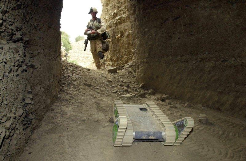 SOLDIER MANEUVERS ROBOT
