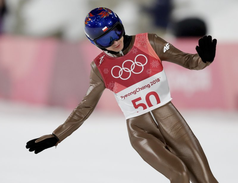 The Latest: Stoch win ski jumping's large hill at Olympics