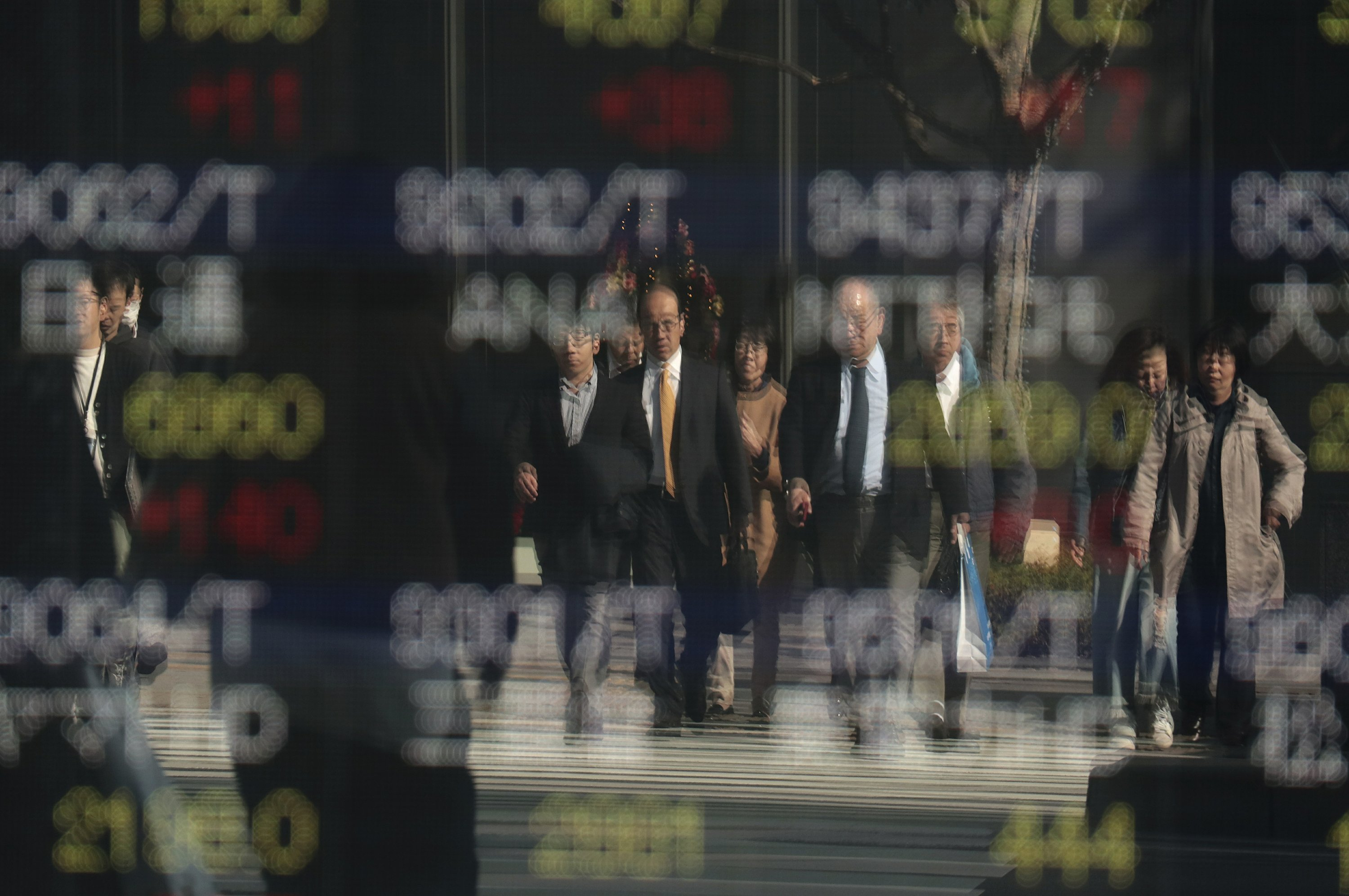 Asian shares mixed following North Korean missile launch