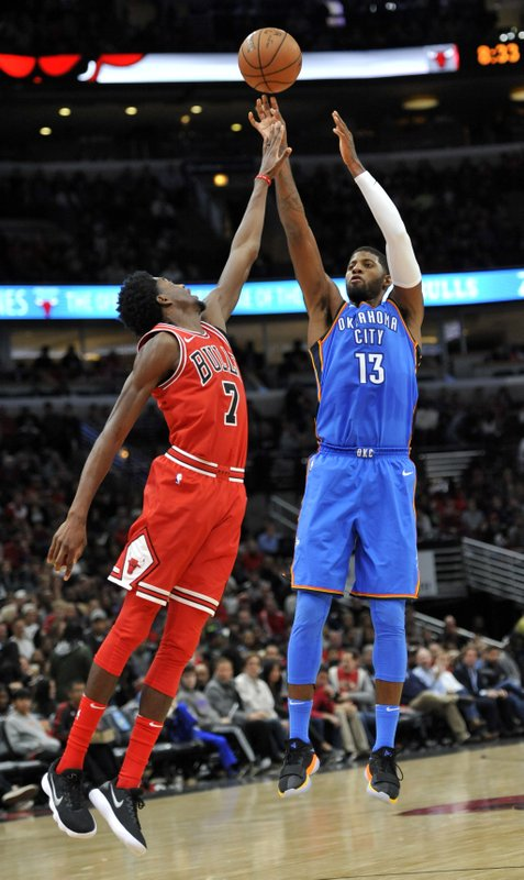 Paul George, Justin Holiday