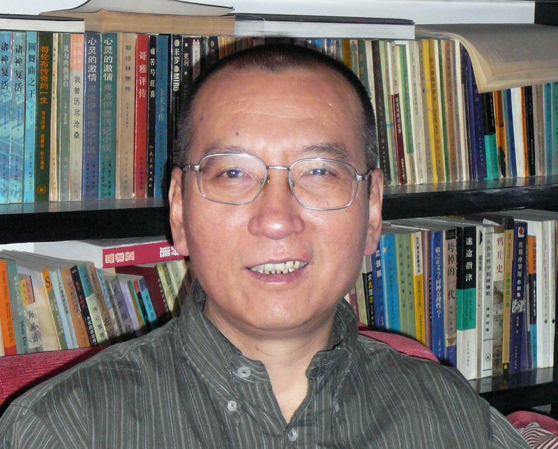In this April 2008 file photo shows Chinese dissident Liu Xiaobo as he poses for a photographer in China. The judicial bureau in the northeastern Chinese city of Shenyang says jailed Nobel Peace Prize laureate Liu Xiaobo has died of multiple organ failure Thursday, July 13, 2017, at age 61.