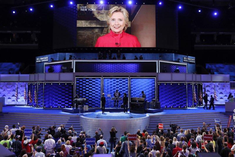 The Latest: Clinton sees 'biggest crack' in glass ceiling