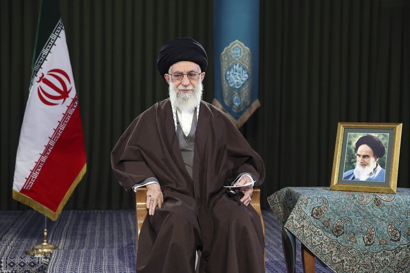 In this picture released by official website of the office of the Iranian supreme leader on Monday, March 20, 2017, Supreme Leader Ayatollah Ali Khamenei sits in a session to deliver his message for the Iranian New Year, or Nowruz, Iran. Nowruz, a festival to celebrate the new Persian year starts with the spring. Iranians follow the Persian solar year, and this year, they begin the year 1396. A portrait of the late revolutionary founder Ayatollah Khomeini is placed at right.