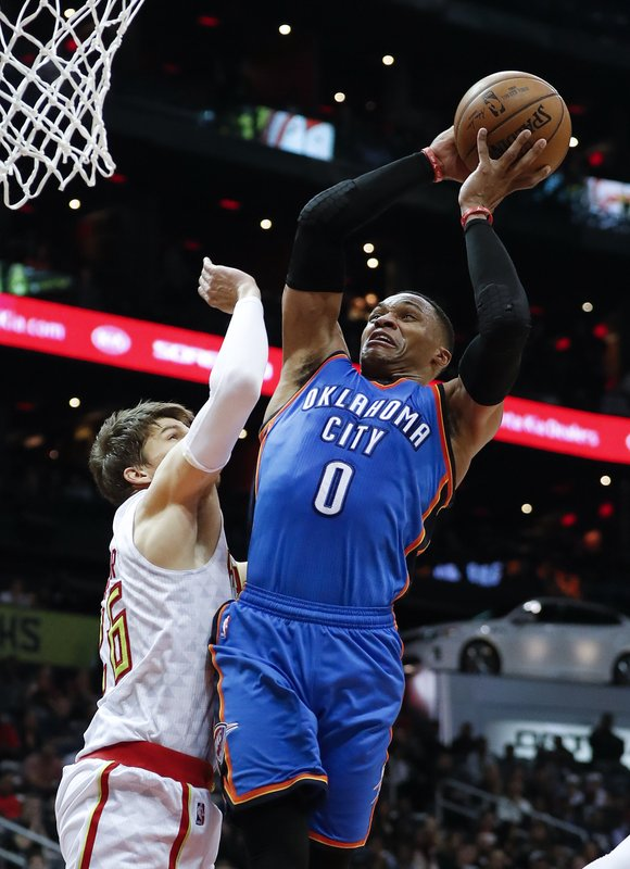 Westbrook's triple-double leads Thunder past Hawks, 102-99