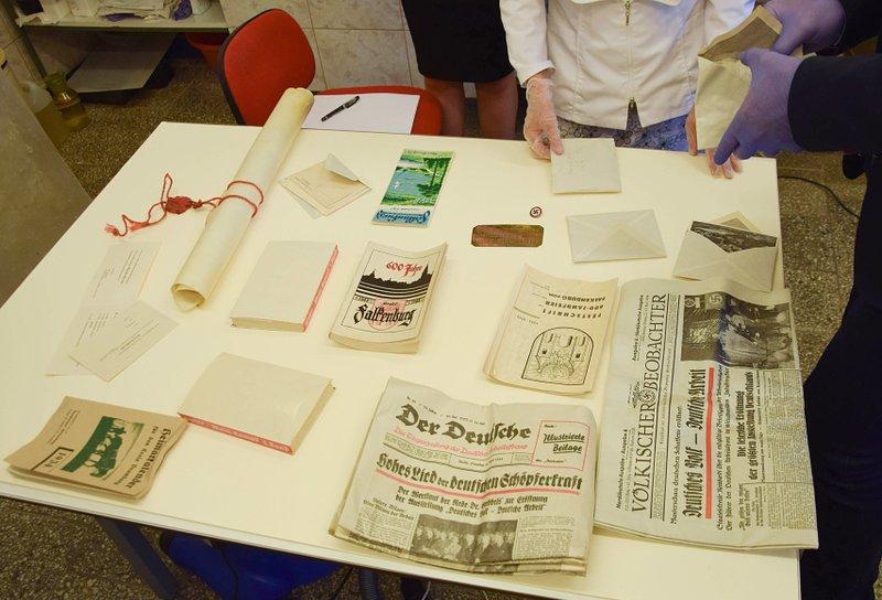 Nazi-era coins, photos, Hitler's book found in Poland