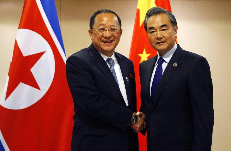 Ri Yong Ho, Wang Yi