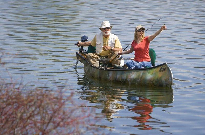 Bill Plantan and Jen Koski go fishing