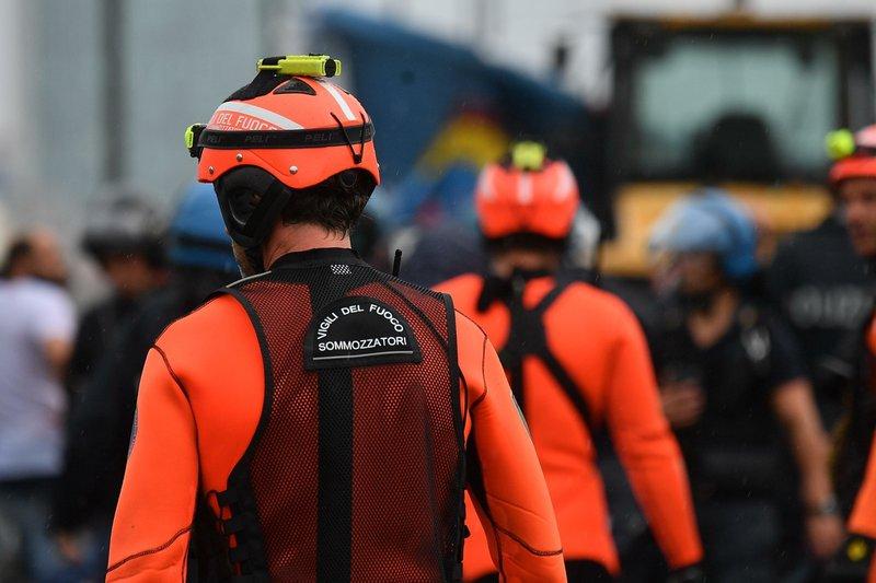 Italian bridge collapse sends cars plunging, killing 26