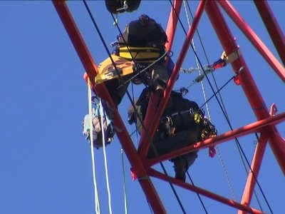 Protesters Climb Washington Crane