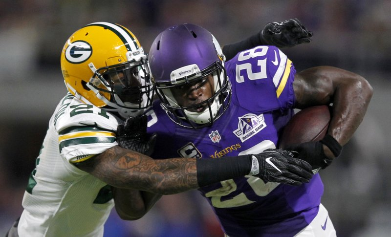 cb140c320 The Latest  Adrian Peterson ruled out with knee injury