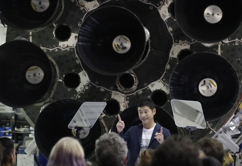 bee0e62712 Japanese billionaire Yusaku Maezawa speaks after SpaceX founder and chief  executive Elon Musk announced him as the first scheduled private passenger  on a ...