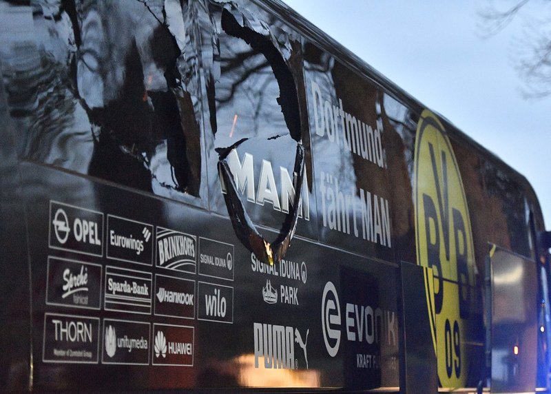 A window of Dortmund's team bus is damaged after an explosion before the Champions League quarterfinal soccer match between Borussia Dortmund and AS Monaco in Dortmund, western Germany, Tuesday, April 11, 2017.