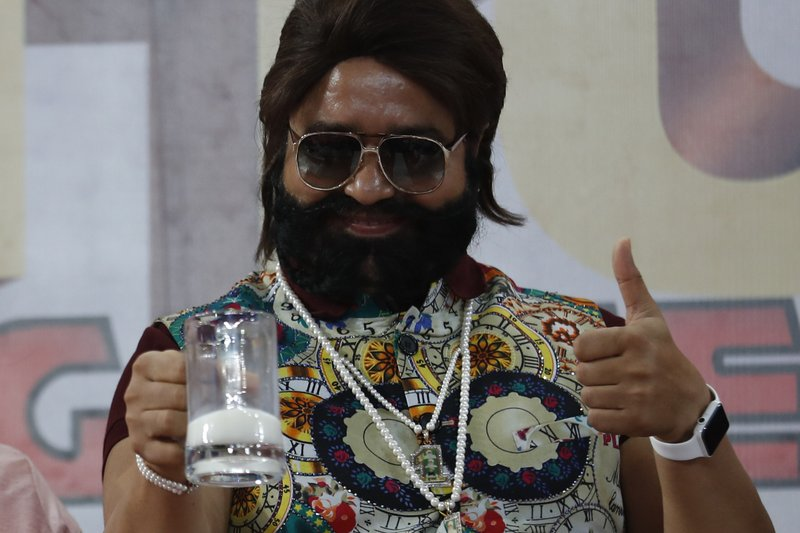 "In this May 17, 2017, file photo, Indian spiritual leader turned actor who calls himself Dr. Saint Gurmeet Singh Ram Rahim Insan gestures as he holds up a glass of milk at a ""Cow Milk Party"" during the premiere of the movie ""Jattu Engineer"" in New Delhi, India. A judge on Monday, Aug. 28, 2017, sentenced the flamboyant and controversial Indian spiritual guru to prison on charges of raping two female followers."