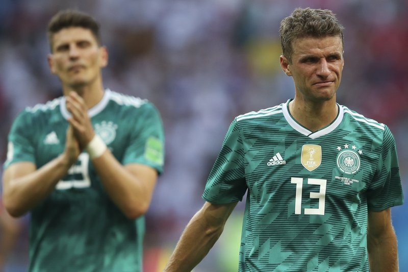 Germany's Thomas Mueller, right, and Mario Gomez walk on the pitch at the end of the group F match between South Korea and Germany, at the 2018 soccer World Cup in the Kazan Arena in Kazan, Russia, Wednesday, June 27, 2018. Defending champion Germany has been eliminated in the group stage of the World Cup in a 2-0 stoppage-time loss to South Korea and Sweden has topped Group F with a 3-0 win over Mexico.