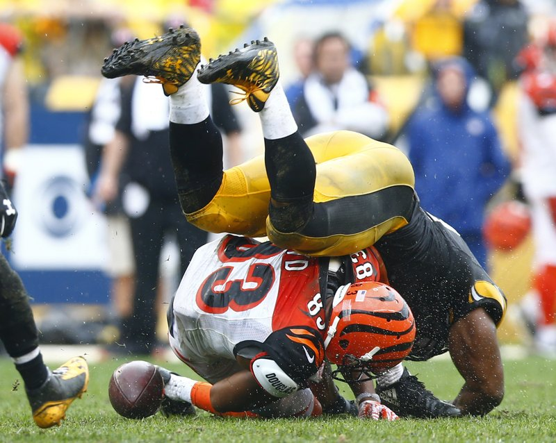 39f70e5bc 18, 2016, file photo, Cincinnati Bengals wide receiver Tyler Boyd (83)  fumbles the ball as he is hit by Pittsburgh Steelers outside linebacker  James ...