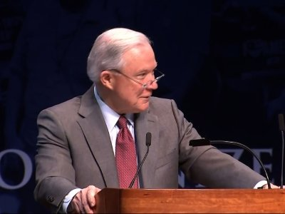 Sessions Laughs as Students Chant 'Lock Her Up'