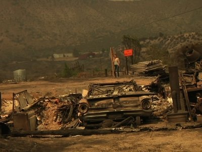 Raw: Fire Burns Homes, Leaves Charred Landscapes