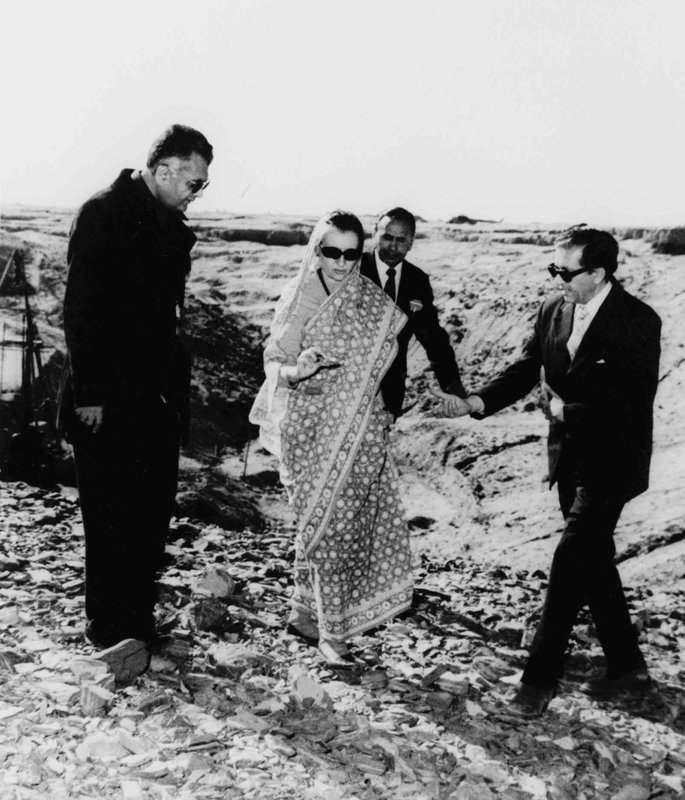 In this Dec. 22, 1974, file photo, Indian Prime Minister Indira Gandhi, center, examines a piece of rock at the nuclear test site in Pokhran, southeastern India. Gandhi is flanked at left by K.C. Pant, Indian minister of energy and Dr. H.C. Sethna, right, then chairman of the Atomic Energy Commission. In May 1974, India conducted a nuclear test in the Rajasthani desert, the first nation to do so outside the permanent U.N. Security Council.