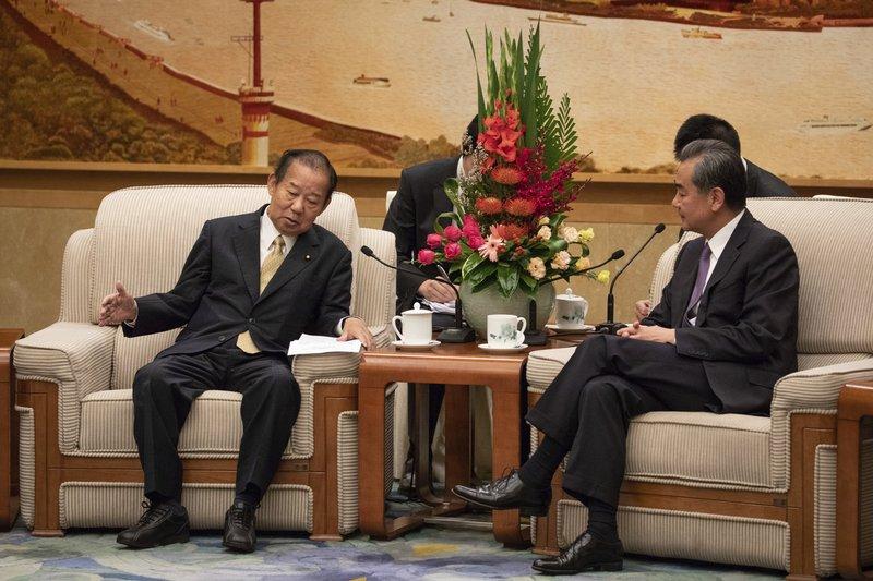 Wang Yi, Toshihiro Nikai