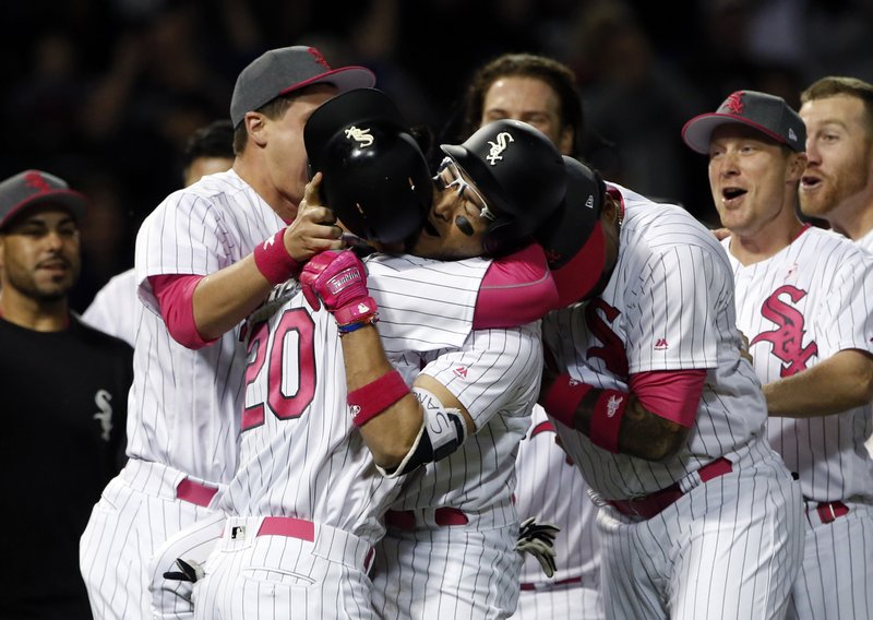 Chicago White Sox's Yolmer Sanchez, center right, celebrates with Tyler Saladino after they defeated the San Diego Padres in an interleague baseball game in Chicago, Saturday, May 13, 2017. (AP Photo/Nam Y. Huh)