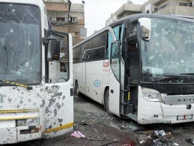 Raw: Twin Blasts Kill 40 in Syria's Capital