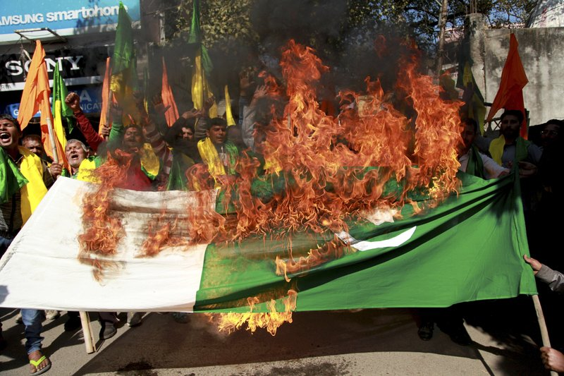 In this Feb 23, 2016 file photo, activists of Jammu and Kashmir Dogra front shout slogans and burn Pakistani national flag during a protest against militants attack in Pampore in Kashmir where nine people were killed in Jammu, India. No issue has bedeviled India-Pakistan relations like the disputed Himalayan region of Kashmir. As the 70th anniversary of India-Pakistan Partition comes up next week, relations between the two nations are as broken as ever.