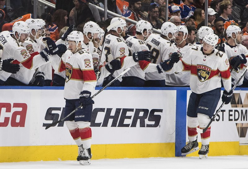 detailing ebff1 553ca Trocheck scores 3 times in 3rd as Panthers beat Oilers 7-5