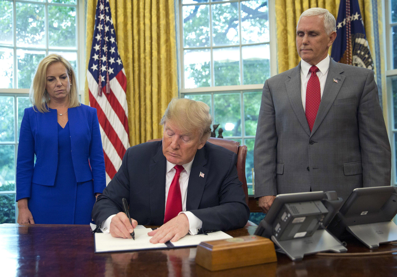 In reversal, Trump orders halt to his family separation rule