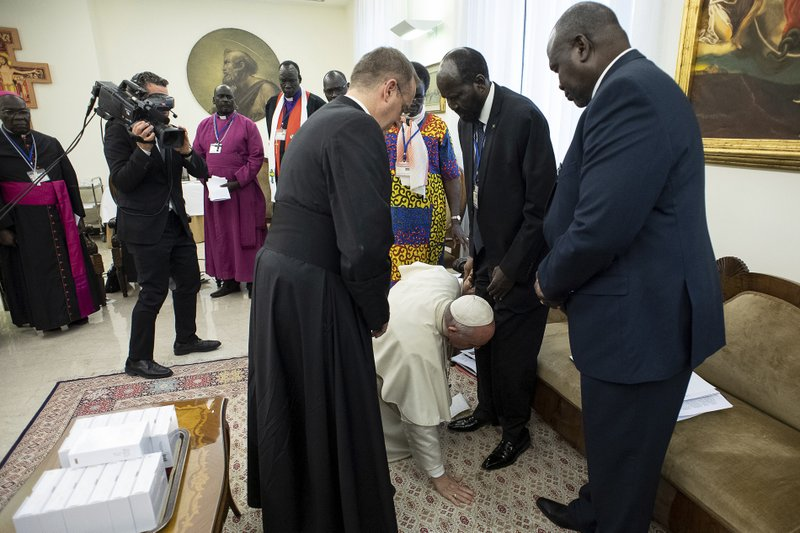 Image result for apnews and pope kisses feet