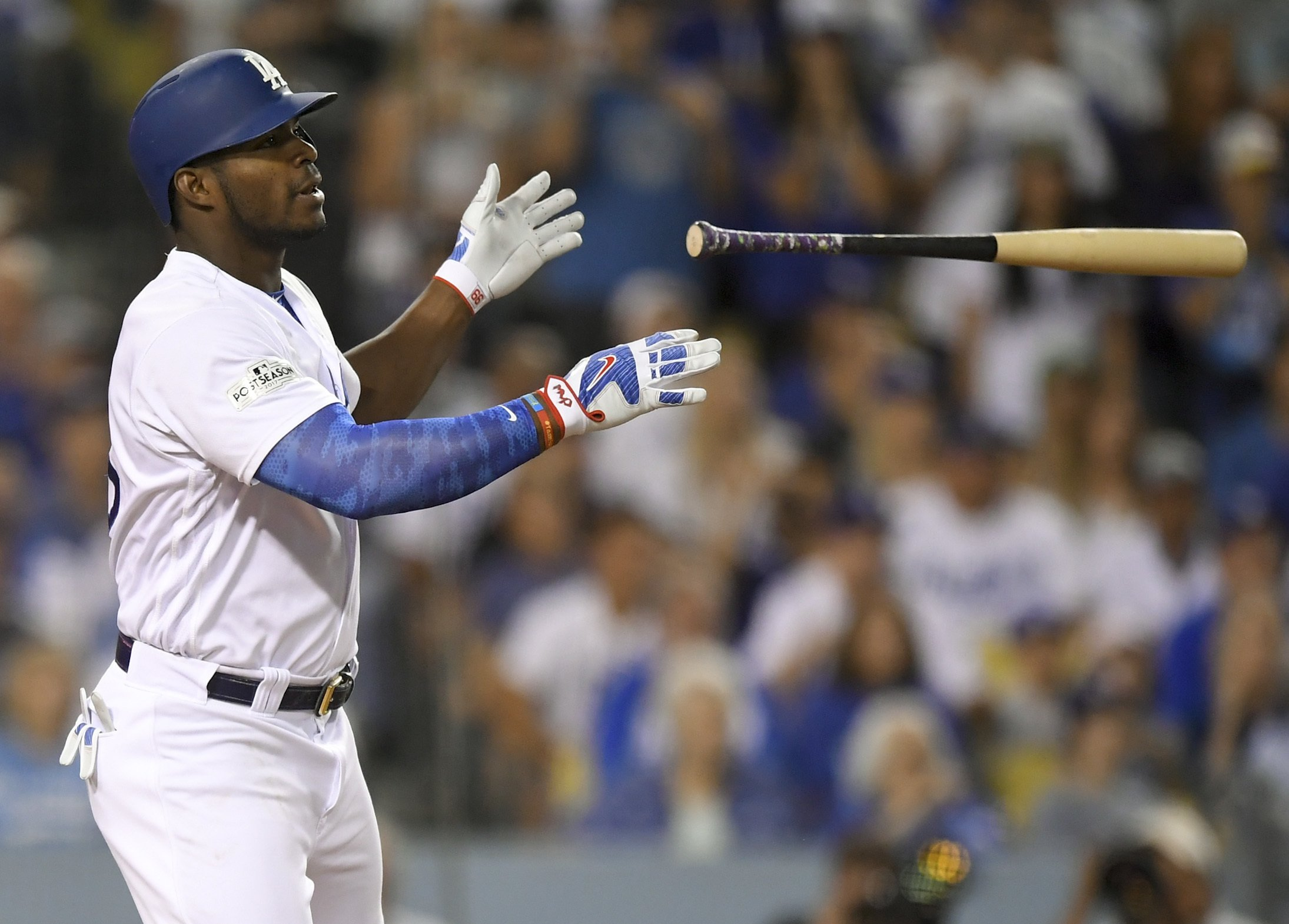 Los Angeles Dodgers  Yasiel Puig celebrates after a single against the  Arizona Diamondbacks during the fourth inning of Game 2 of baseball s  National League ... 770d8c2ad
