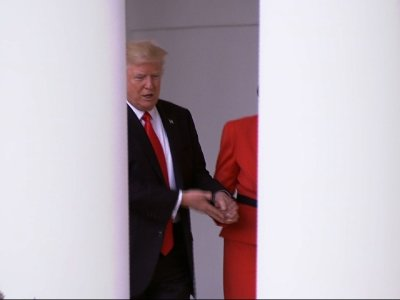 Raw: Trump, May Hold Hands Outside White House