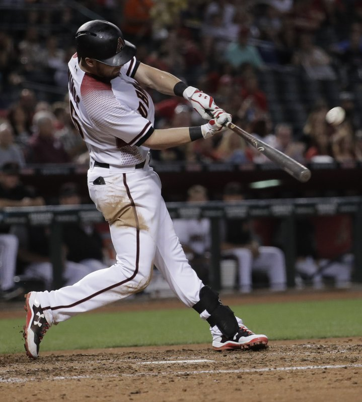 Arizona Diamondbacks' Chris Owings connects on a grand slam home run against the San Diego Padres during the fifth inning of a baseball game, Monday, April 24, 2017, in Phoenix. (AP Photo/Matt York)