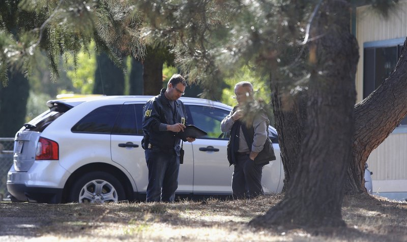 The Latest: California shooter wasn't allowed to have guns