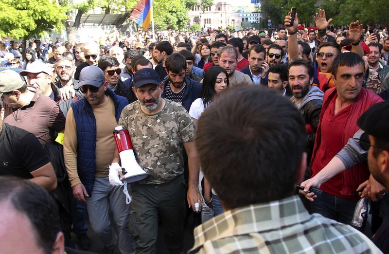 Armenian protest leader Nikol Pashinian, center, marches with other demonstrators celebrating Armenian Prime Minister's Serzh Sargsyan's resignation in Republic Square in Yerevan, Armenia, Monday, April 23, 2018.