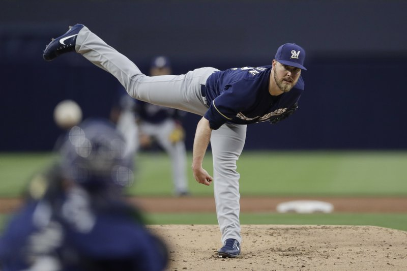 Milwaukee Brewers starting pitcher Jimmy Nelson pitches to a San Diego Padres batter during the first inning of a baseball game, Tuesday, May 16, 2017, in San Diego. (AP Photo/Gregory Bull)
