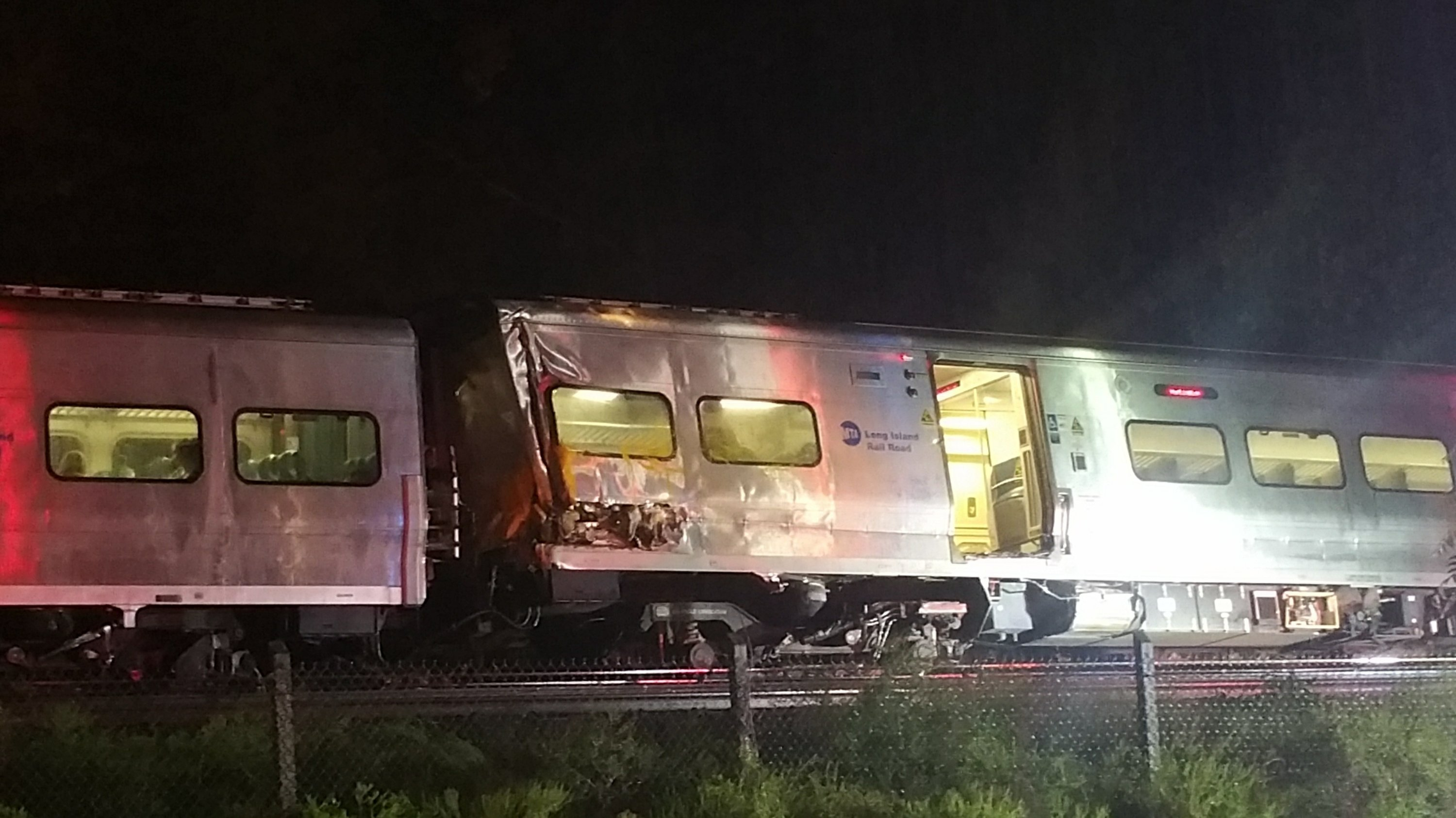 Governor: Trains side-swiped each other, causing derailment