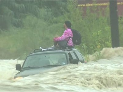 Texas Man Stuck on Top of SUV in High Water